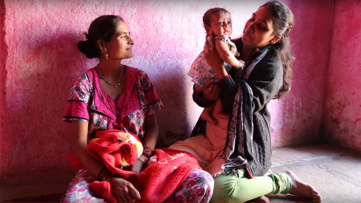 Midwife, mother and baby in India